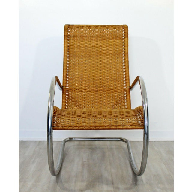 For your consideration is a beautiful rocking chair, made of tubular chrome and rattan, in the style of Mies Van Der Rohe,...