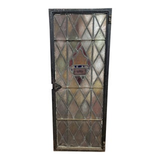 Antique Stained Glass Window in Heavy Metal Frame For Sale
