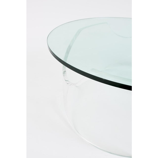 A beautiful, sculptural lucite base with a round glass top. We love the organic and sculptural presence of this lucite...