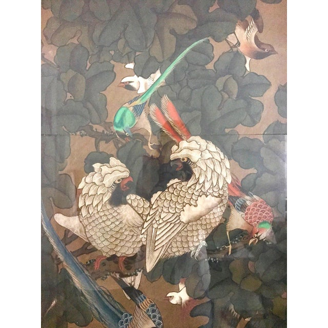 Unusual and beautiful three panel folding wood room divider or screen depicting an array of exotic oriental birds in...