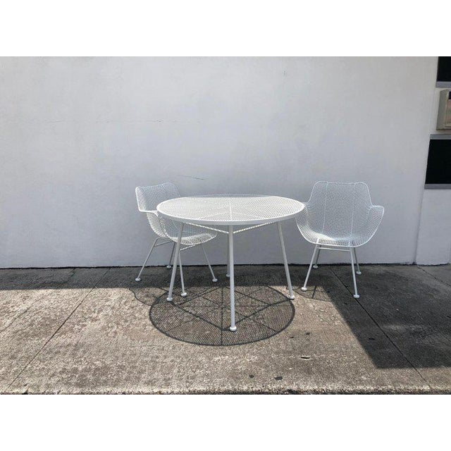 This stylish five piece set of mid-century modern patio furniture was designed by Russell Woodard and is known as the...