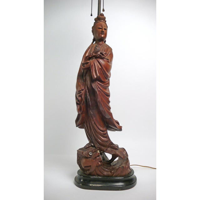"""Attributed to William 'Billy' Haines this hand-carved asian figural """"artifact"""" lamp is absolutely exquisite. Both the..."""