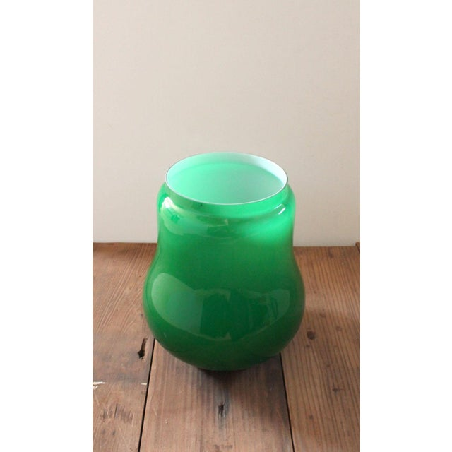 Large Italian made green vase with a white lining in the style of Carlo Moretti. Large enough base this could be used as a...