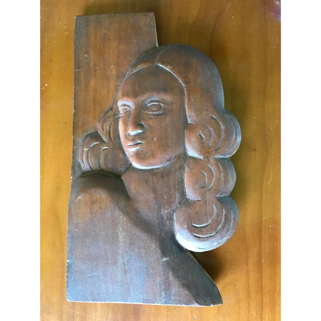 """Offering a 11"""" by 6"""" folk portrait frieze in relief carving of a woman. Great deco period stylization. Item has mellow old..."""