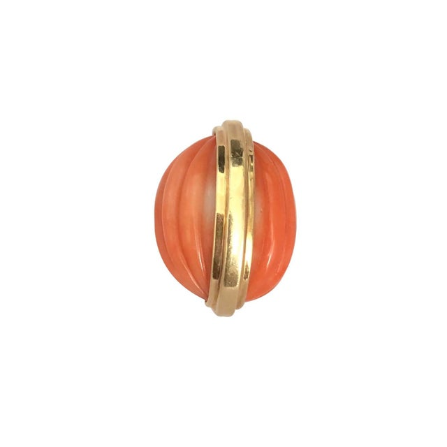 A fun and different vintage 14K gold ring with a carved coral ribbed design, resembling a walnut. The coral has a band...