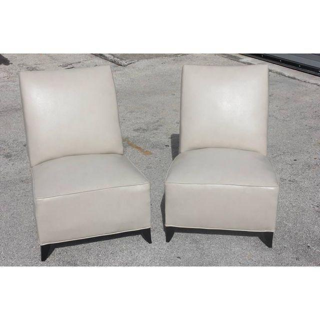 Fine pair of French Art Deco club chairs, circa 1940's. These beauties have been newly upholstered and are ready to...