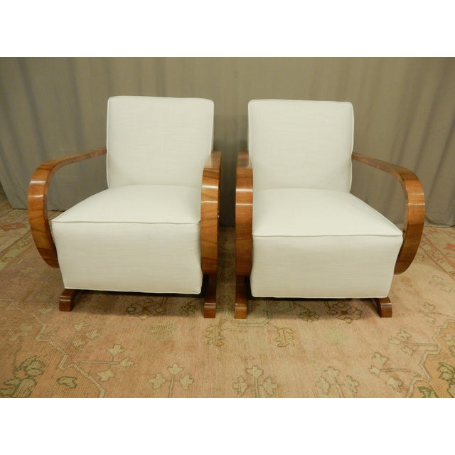 Pair of very chic Art Deco walnut armchairs. They are extremely comfortable. They come from Northern Europe in the 1930s.