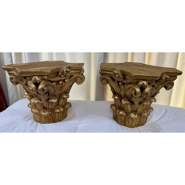 C. 1940s Pair of Corinthian Capitals. Rows of acanthus leaves , volute scrolls rising from cauliculus stalks and fleuron...