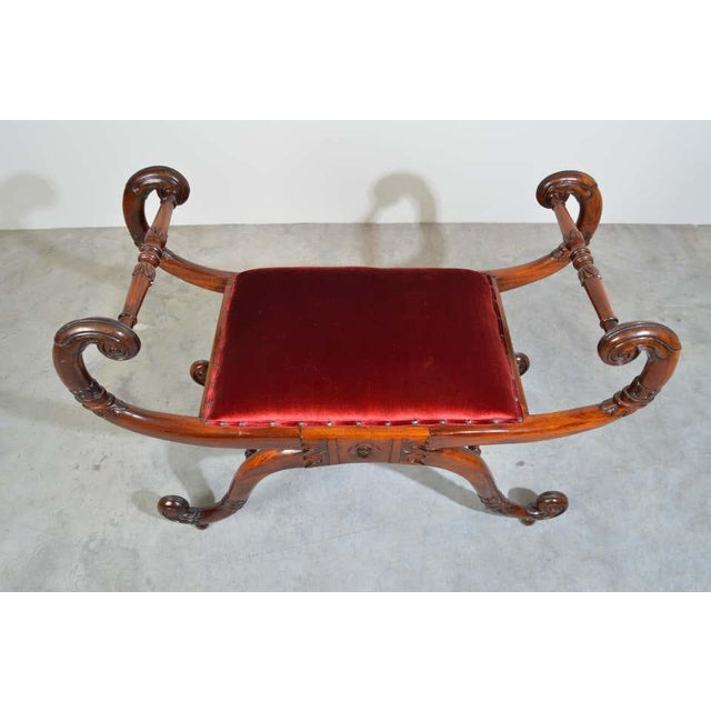 Neoclassical style bench Carved mahogany frame with velvet overstuffed seat cushion having flanking scroll armrests,...