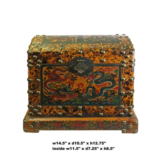 This is a handmade Chinese accent decorative trunk shaped box made of wood and finished with a distressed yellow red base...