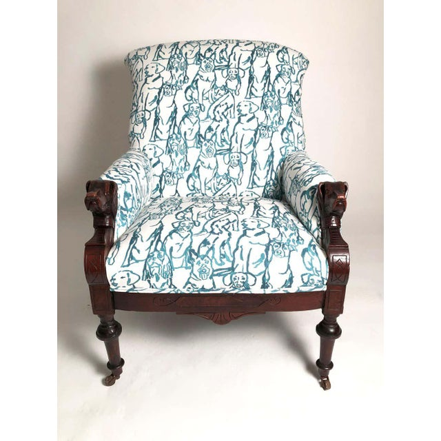 A very comfortable and well proportioned Victorian armchair, circa 1875-1880, with carved dog head armrests in mahogany,...