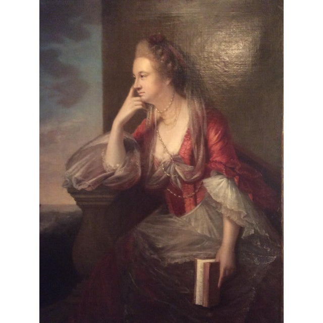 Beautiful unsigned oil painting portrait of a woman holding a book and looking out ...possibly thinking or waiting for her...
