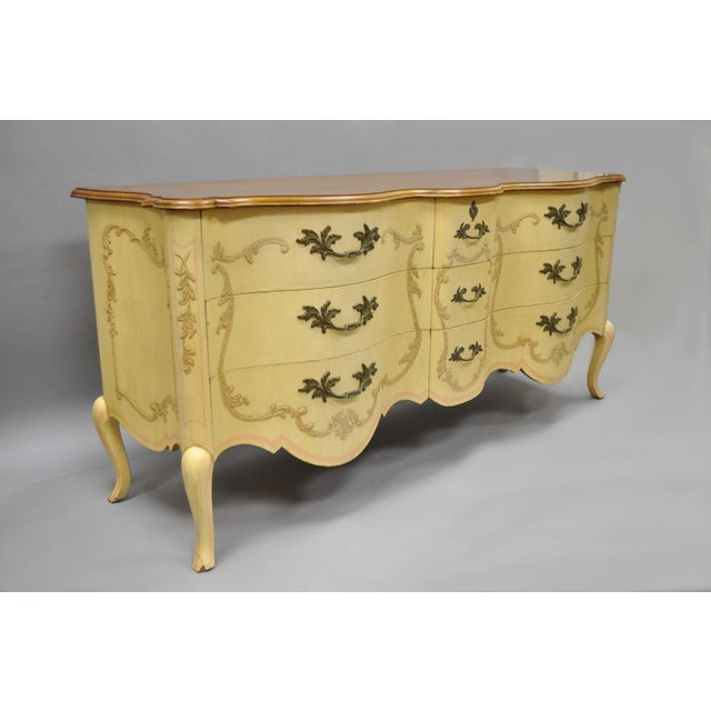 French Provincial Louis XV style walnut dresser/credenza by John Widdicomb. Item features beautiful wood grain, shapely...