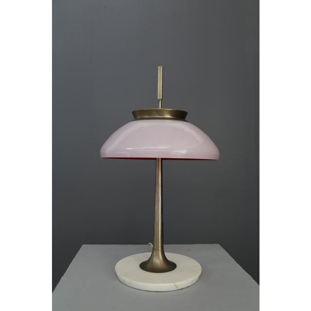 Table lamp Stilnovo Mod 8091 , milan 1950. original label. Marble base, brass frame and lampshade in pink layered glass....