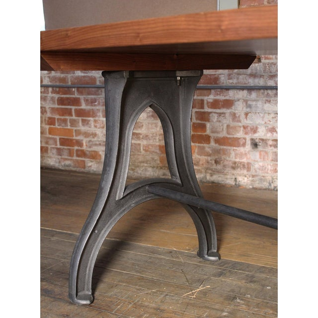 Bespoke industrial desk with walnut top & cast iron legs. Space between legs measures 57 1/2″, space under stretcher...