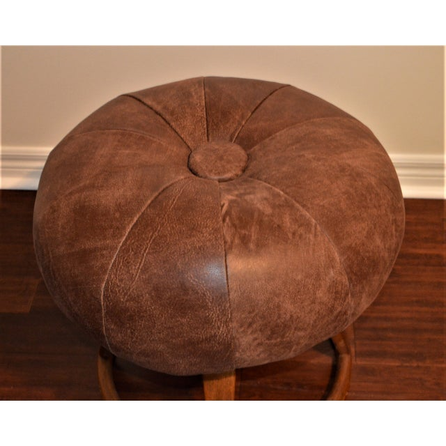 A vantage Bentwood swivel stool or bench in excellent condition. It has been newly upholstered in an Italian distressed...