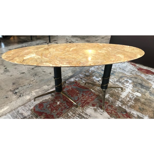 Mid-Century Modern Italian yellow marble and brass oval coffee table, 1950 Brass in original patina create a vibrant...