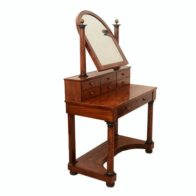 Early 19th Century French Empire to Biedermeier transitional dressing table in flame mahogany veneers, having an arched...