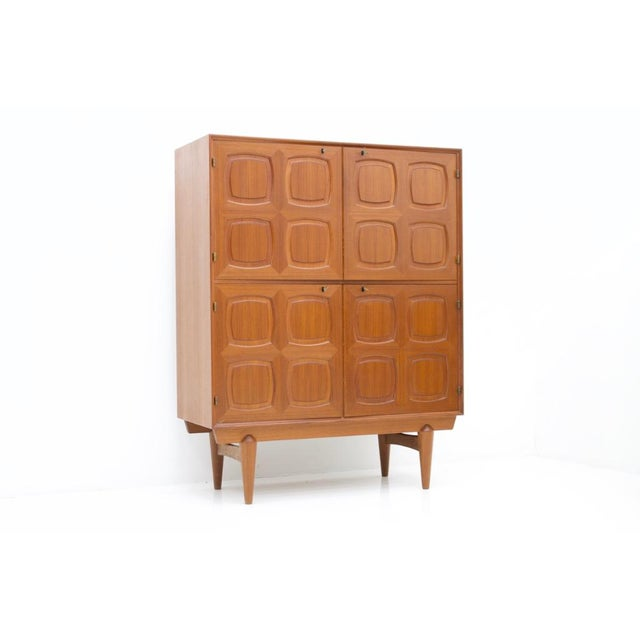 Very nice teak highboard by Adolf Rastad and Rolf Relling made by Gustav Bahus from Norway, designed in 1960s. Massive...