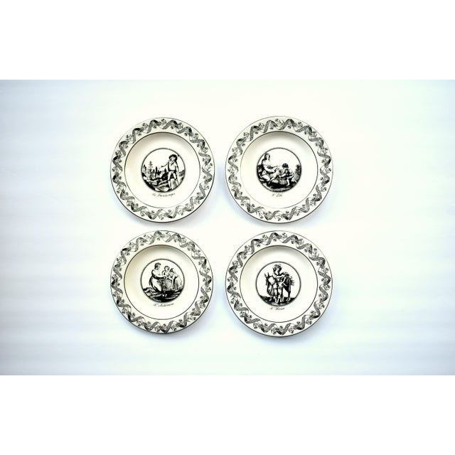 A set of four (4) vintage small dessert, bread, or canape plates, printed with the black and white neoclassical...