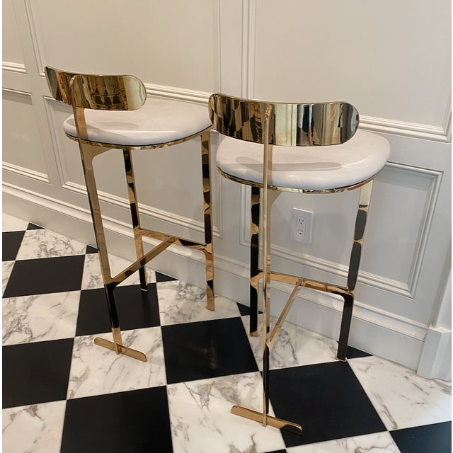 "2 hardly ever used, custom made, beautiful, solid brass bar stools with white leather seats. The seat height is 30"", total..."