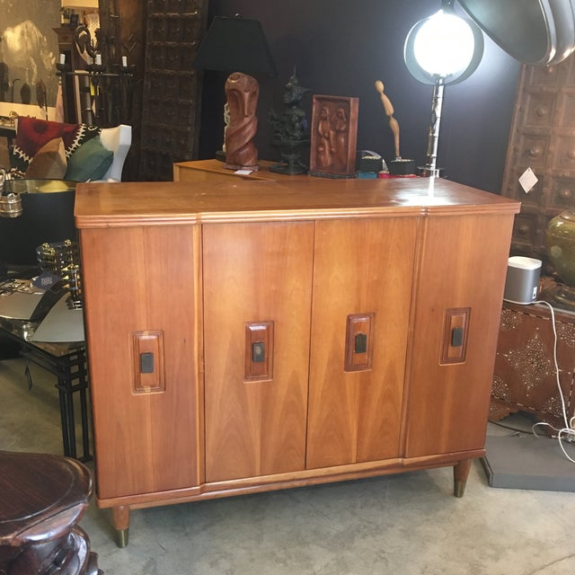 Wonderful mid-century modern chest by John Widdicomb Furniture Maker. The unique height of this chest is only part of its...