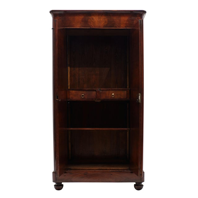 French Restoration antique armoire made of flamed Cuban mahogany. We love the beautiful wood and the reasonable...
