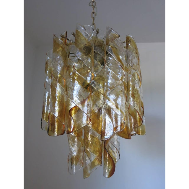 Vintage Italian chandelier with 32 infused amber and clear Murano glasses blown into twisted spiral shapes and brass...