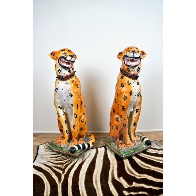 Monumental pair of mid-century Italian ceramic cheetah cat statues. Opposing poses that are colorful & lifelike. Each big...