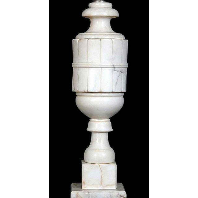 Pair of table lamps fashioned out of alabaster and presented in a Art Deco style. This item can be viewed at our Madison...