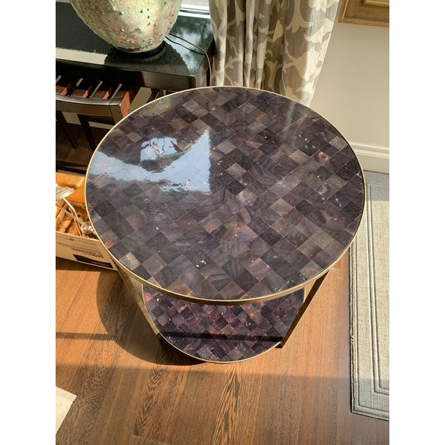 This table has a gold metal finish with a faux tortoise/pen shell top. I have seen this table with an antique glass top,...