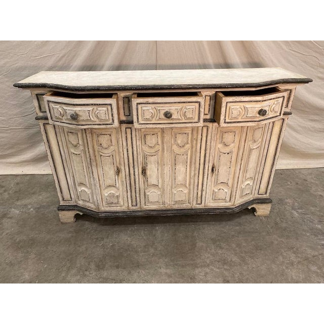 Elegant early 20th C Italian painted console buffet, made of solid wood, with original hardware. This lovely piece...