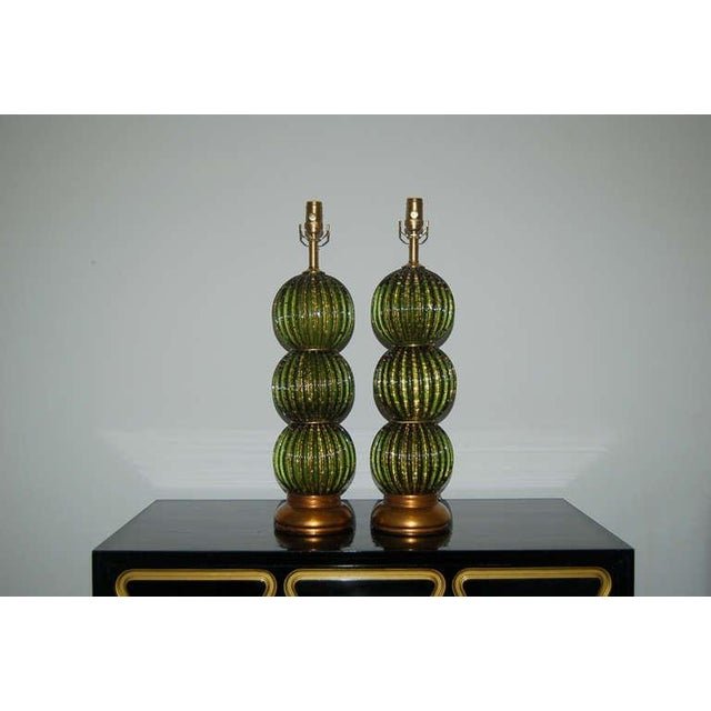 Matched pair of vintage FOREST GREEN stacked ball Venetian glass table lamps with Hollywood Regency elegance. Full of...