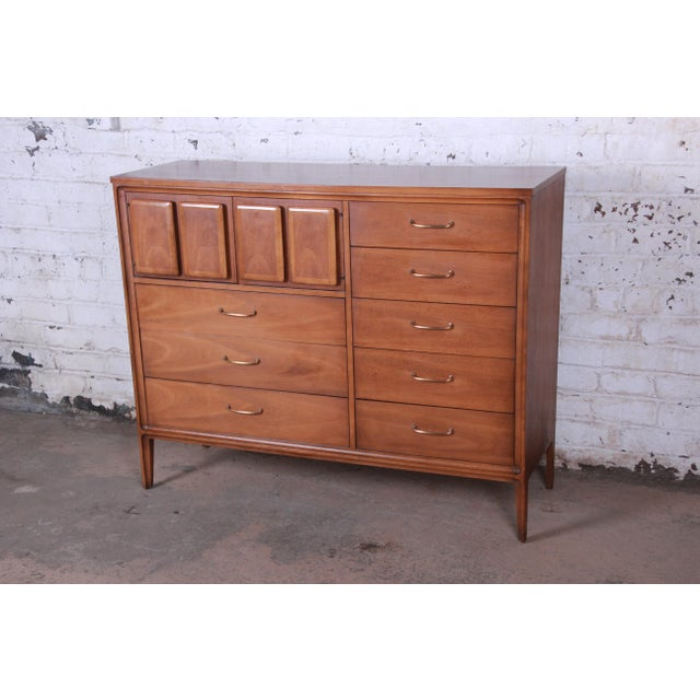Offering a stunning mid-century modern walnut magna gentleman's chest from the Forward '70 line by Broyhill Premier. The...