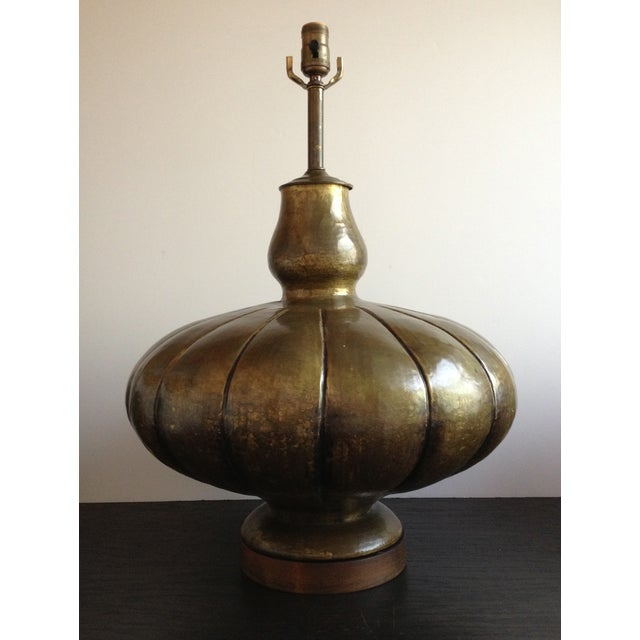 We love the bulbous, organic gourd base form and the hand-hammered texture of this fabulous, vintage 1960s Italian lamp....