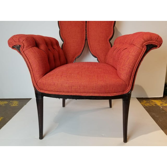 Butterfly wings with new fabrication in a orange mix of color. Excellant condition and great accent chairs. Scale of chair...