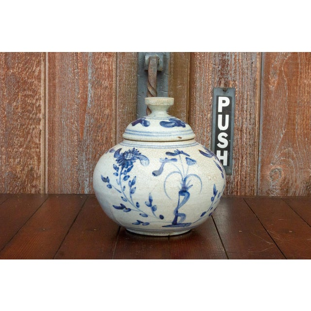 Beautifully decorated antique southern Chinese porcelain jar, it features skillfully painted blue and white floral motifs...