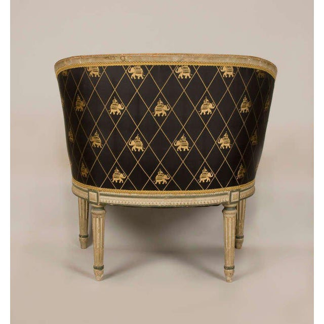 Early 19th century neoclassic bergere. Newly upholstered in fine silk with down cushion. Very comfortable. Deep cream...