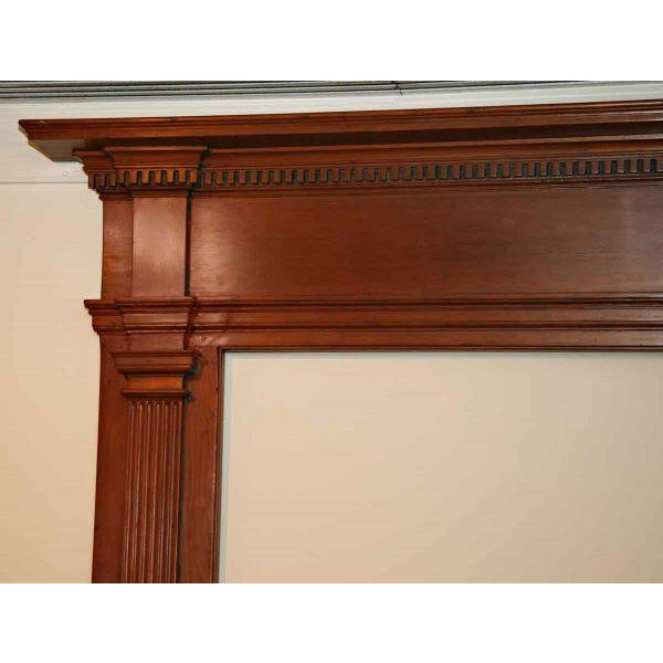 This mantel is very simple, with fluted pilasters on each jamb and simple tablets on each side of the frieze. The shelf is...