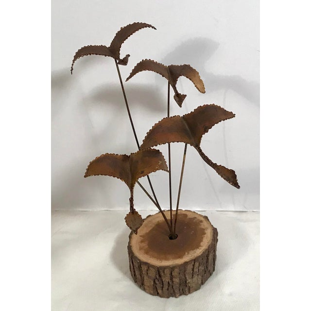 Mid 20th Century, Beautiful metal sculpture featuring four geese in flight with a round wooden base.