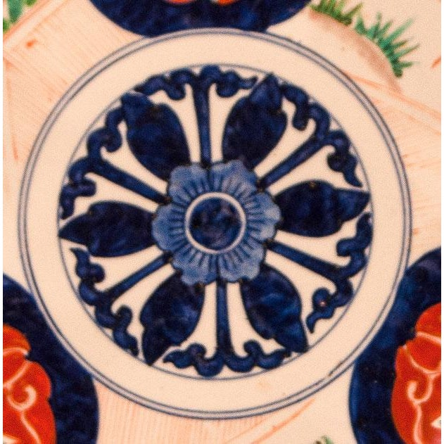 A late 19th Century Japanese Imari charger with a multi petal in the center, circa 1890