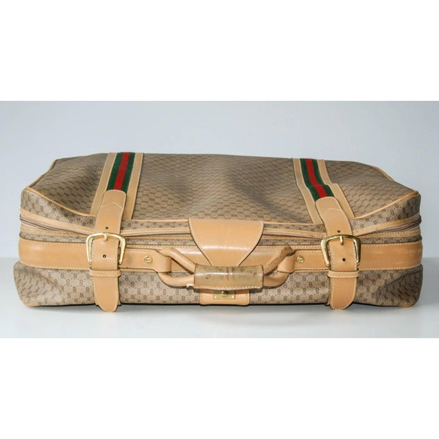 Circa 1970 Travel in high style with this superbly crafted Gucci suitcase. The interior includes Gucci monogrammed...