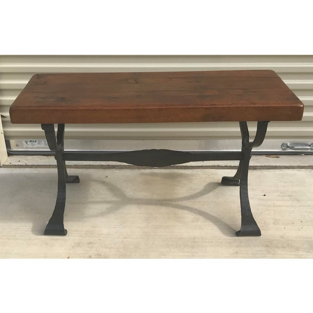 Beautiful very heavy solid wood plank top and iron base coffee table. Really nice!