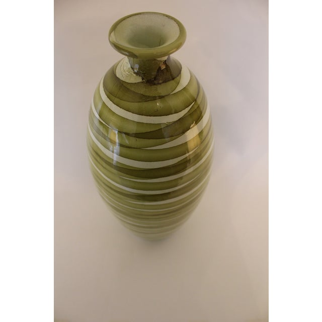 Oval-shape ceramic vase with small mouth. Painted in a beautiful watery green swirled pattern on a cream ground.