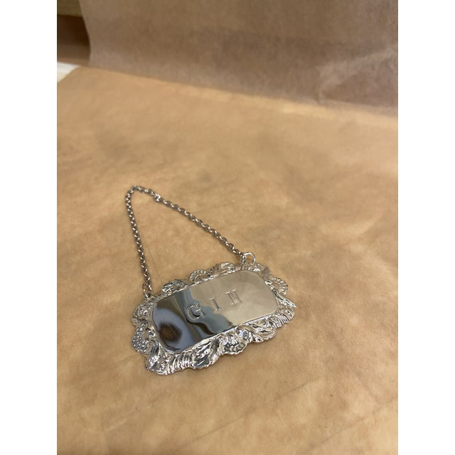 """This is a beautiful vintage decanter tag labeled """"GIN"""". It is a very interesting label for a collection. It is silver..."""