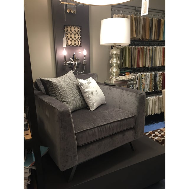 Dibs on this sumptuous chair! Let it surrounds and embrace every inch of you. The sleek lines of this well-designed piece...