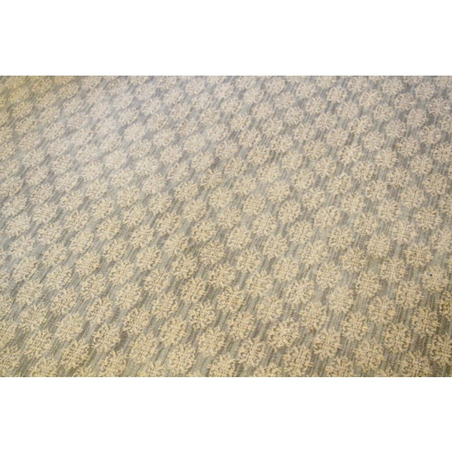 Timeless contemporary Stark Carpet. Pale blue and moss green tones with cream medallion accents throughout. Custom cut to...