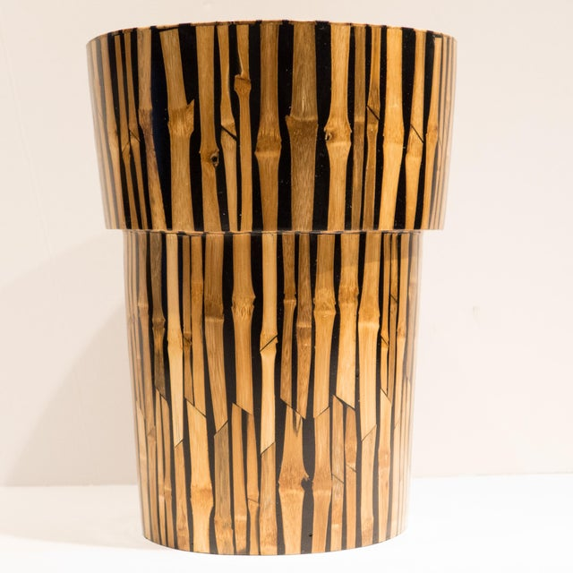 Tall wooden ridged vase with vividly-patterned bamboo inlaid exterior and painted interior. Made in the Philippines, circa...