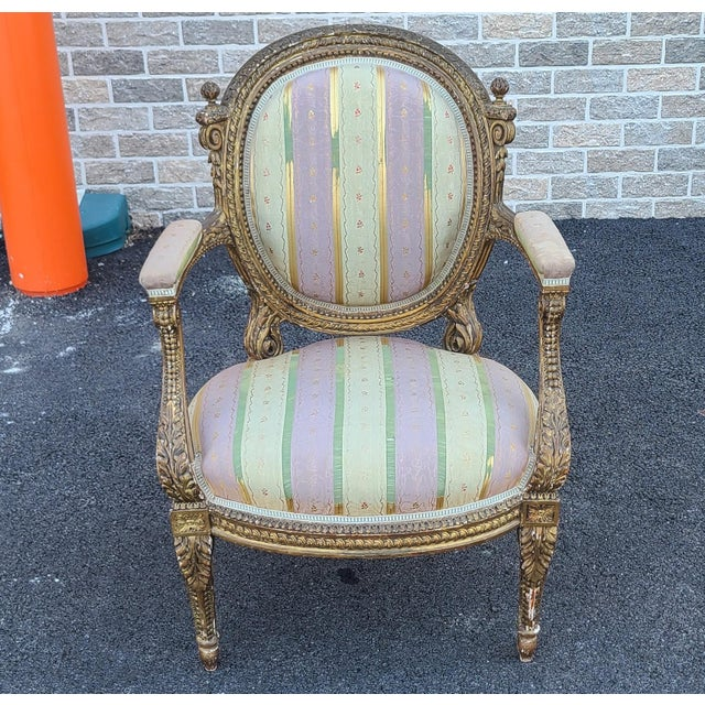 This is a fine antique early 19th century gilded French Louis XVI style parlor armchairs, c1840s. Petite in size at 23...