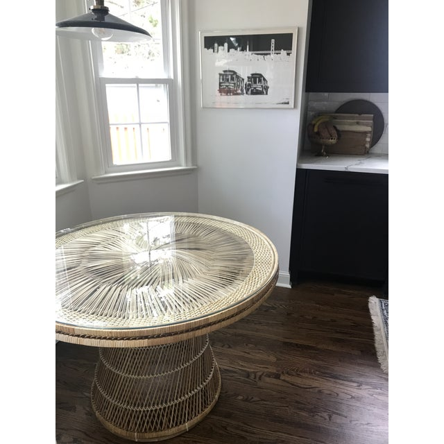 Boho Wicker dining table with glass top. Wicker in good vintage condition, minor breaks but nothing out of the ordinary....